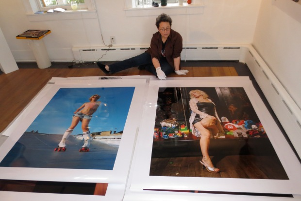 Debbie Nadolney of AMP with my prints on the floor installation day. Girls Girls Girls by Katrina del Mar